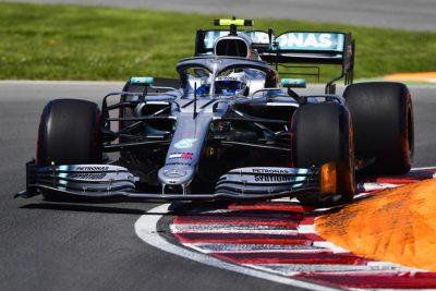 Hamilton vence en Canadá tras una penalización a Vettel